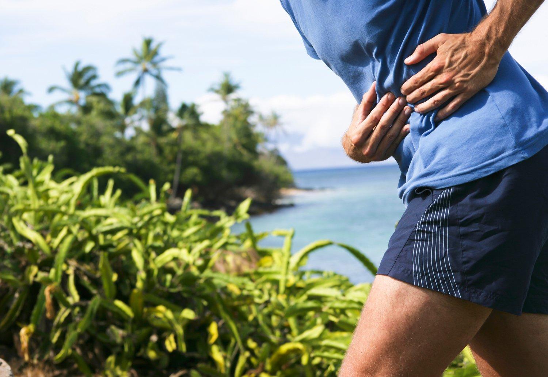 Ноющая боль в правом боку под ребрами: причины, симптомы и методики терапии